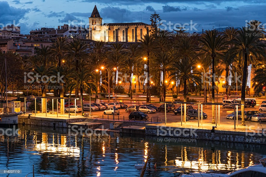 harbor with sailing ships in Palma de Mallorca in sunset stock photo