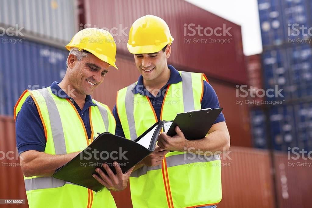 harbor workers at container yard royalty-free stock photo