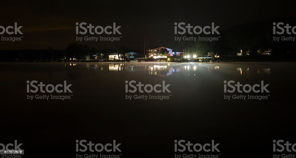 harbour and starlit sky on the werbellinsee by night stock photo
