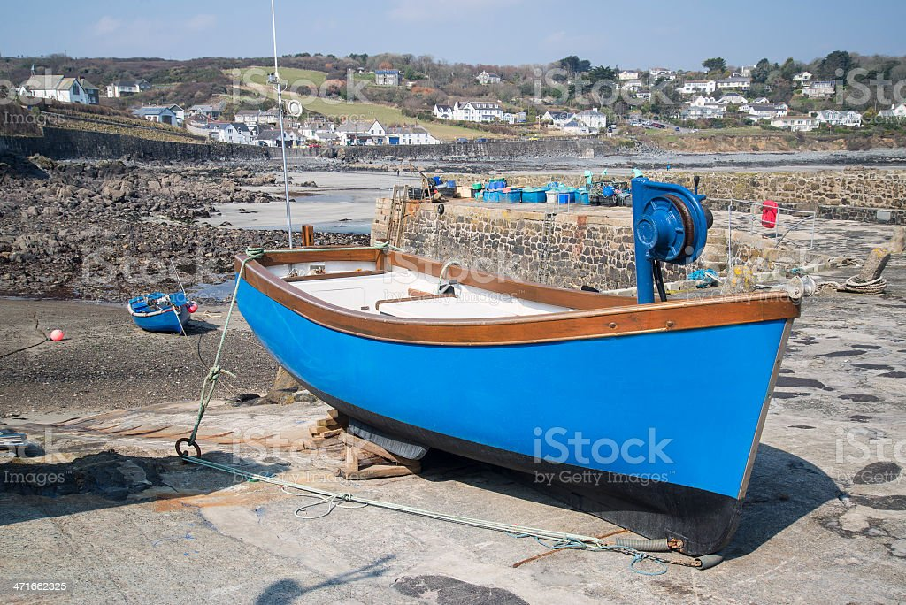 Harbour at low tide with fishing boats Coverack England stock photo