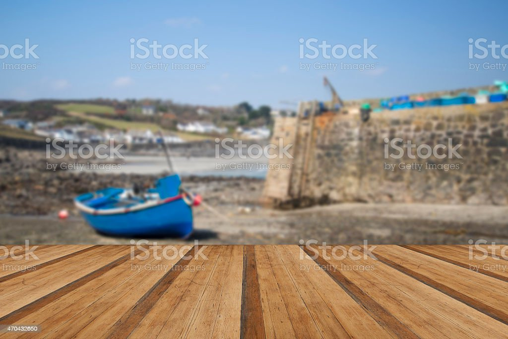 Harbour at low tide with fishing boats in Cornish village stock photo