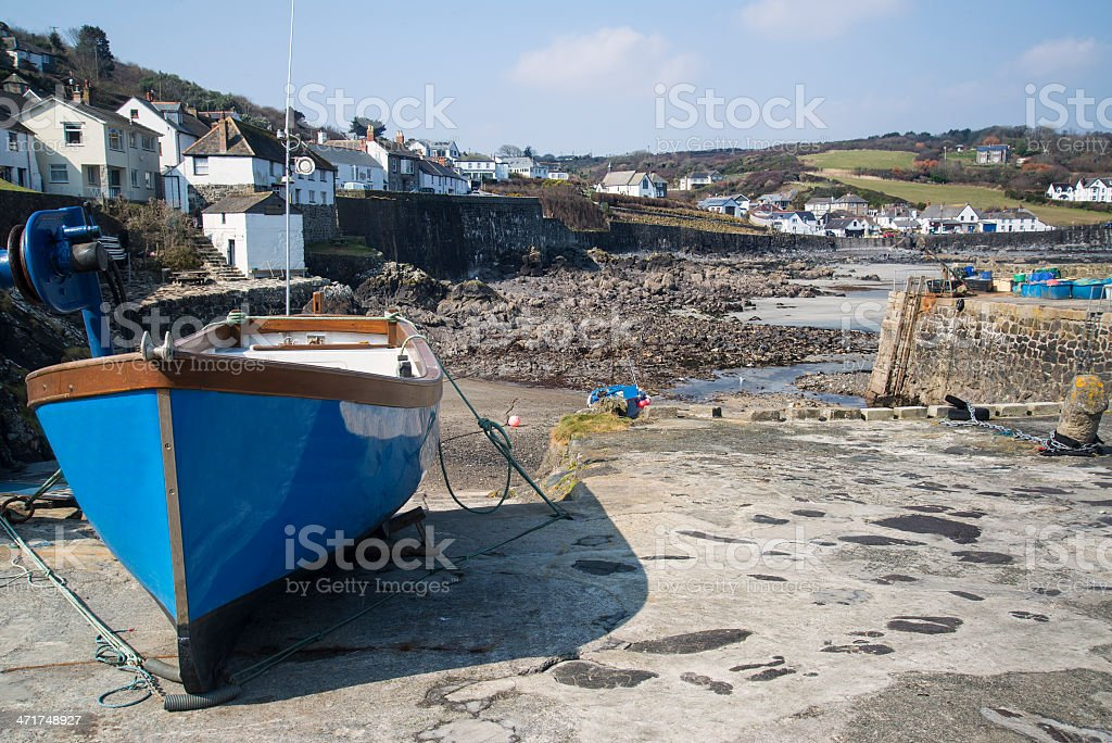 Harbour at low tide with fishing boats stock photo