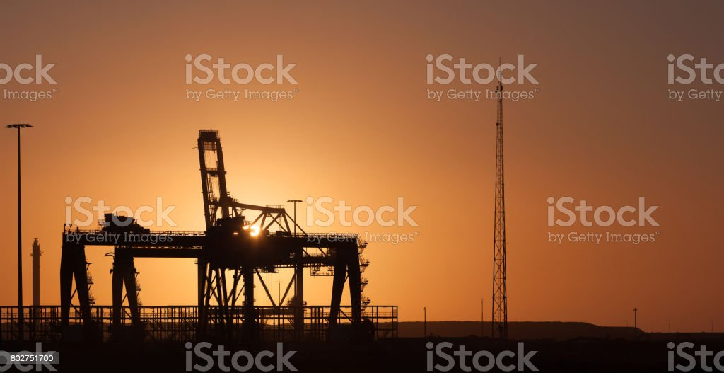 Harbour crane at dusk. stock photo