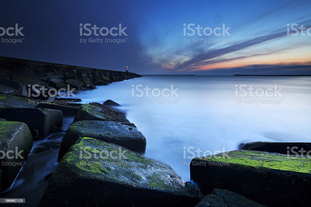 Harbour entrance at sea in IJmuiden, The Netherlands at dusk royalty-free stock photo