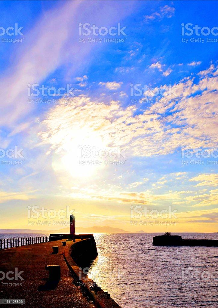 Harbour wall and setting sun stock photo
