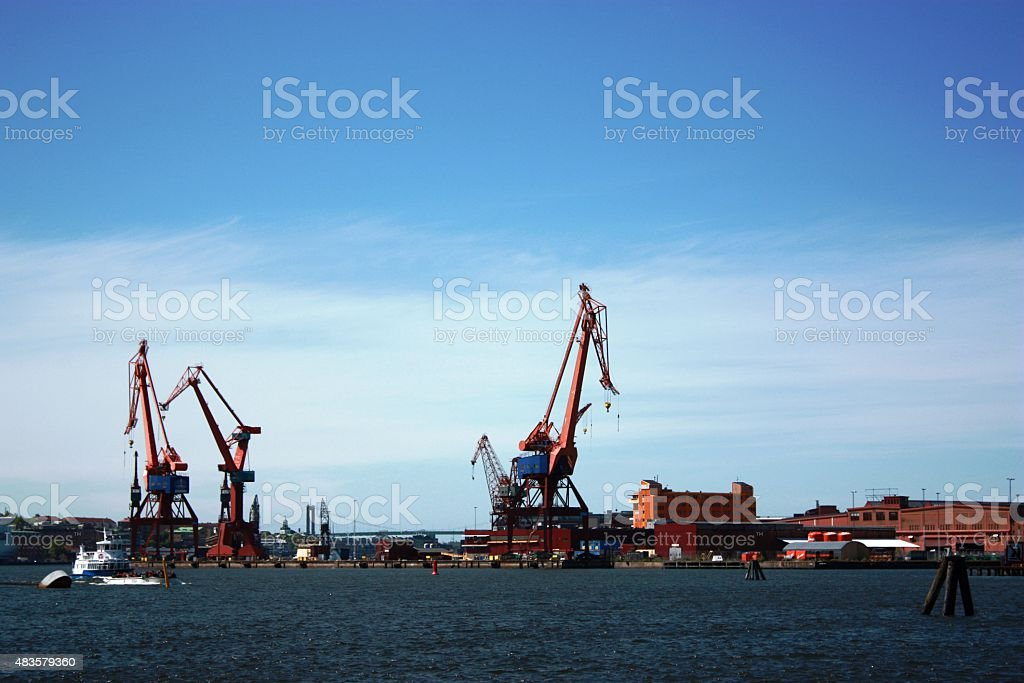Harbour with cranes under blue sky in Gothenburg Sweden stock photo