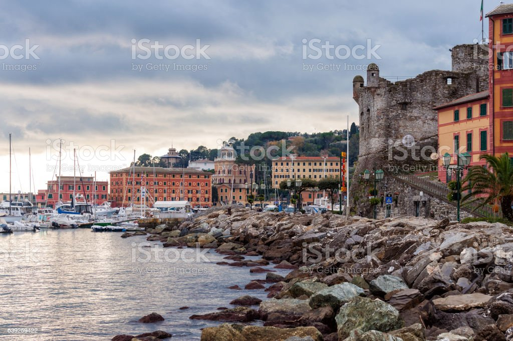 Harbour with old fortress ruins at Santa Margherita Ligure town stock photo