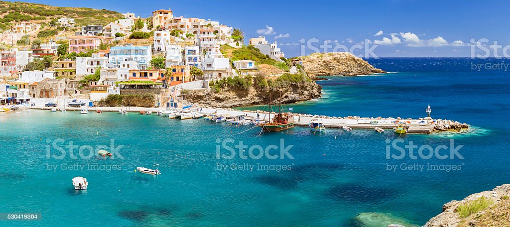 Harbour with vessels, boats and lighthouse in Bali, Crete stock photo