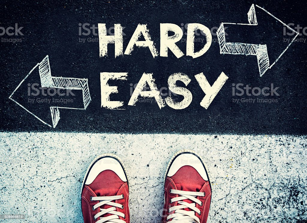 Hard and easy dilemma stock photo