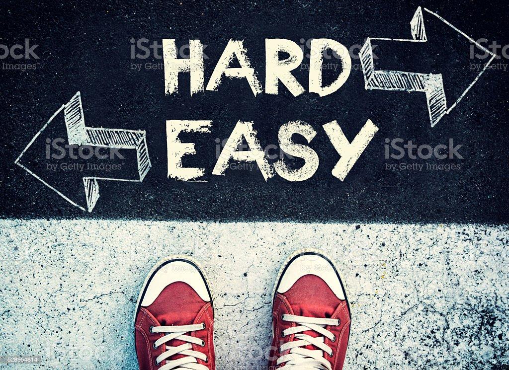 Hard and easy dilemma stock photo