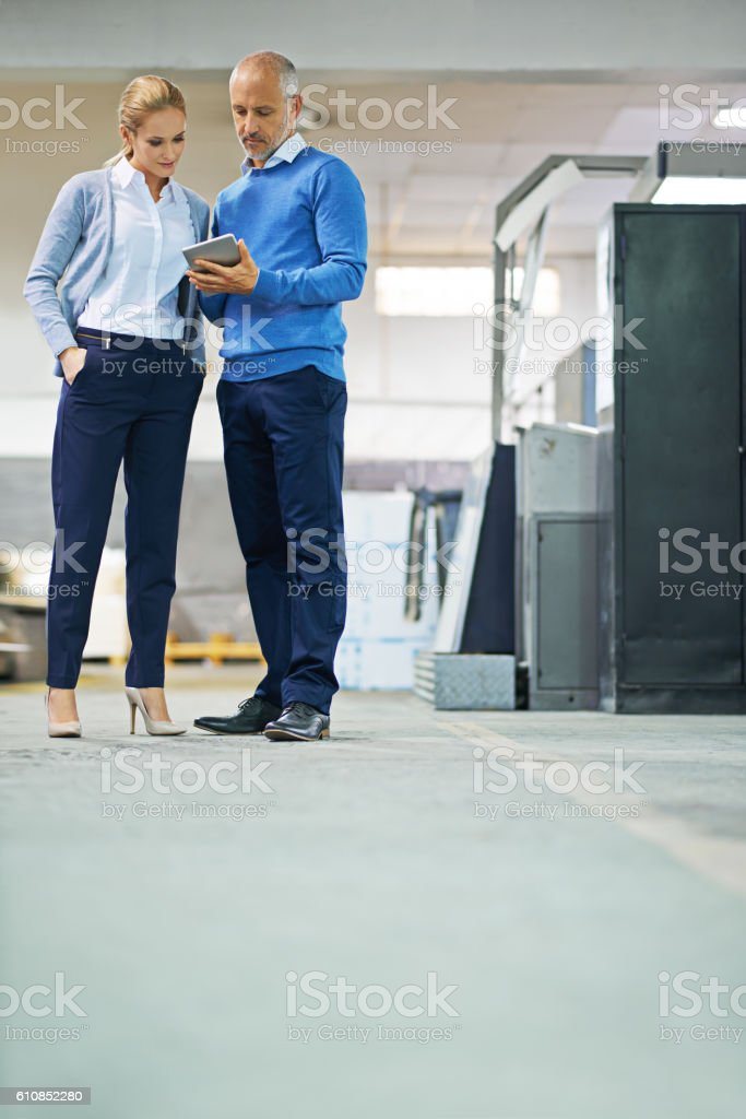 Hard at work on the factory floor stock photo
