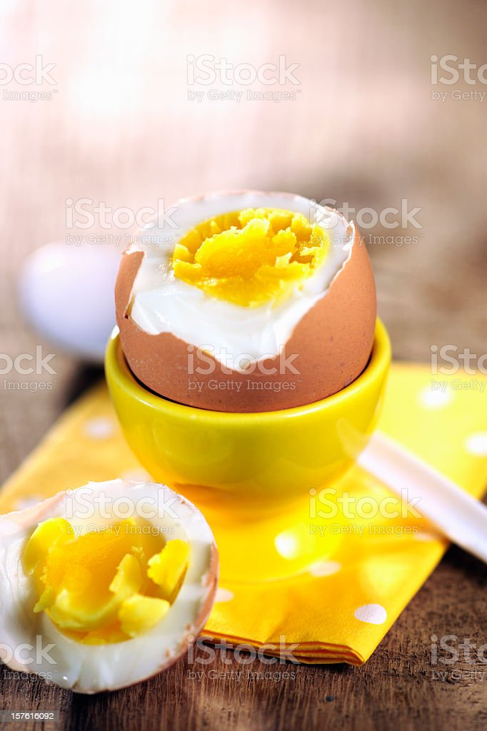 Hard boiled egg on yellow napkin stock photo