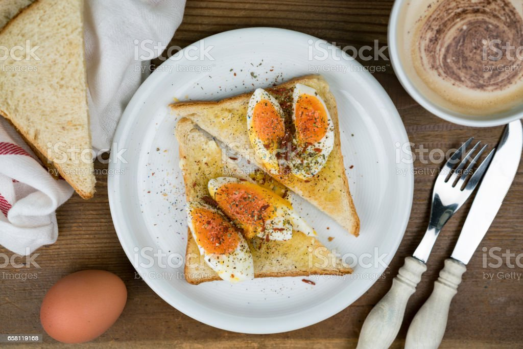 Hard boiled egg sandwich with cappuccino stock photo