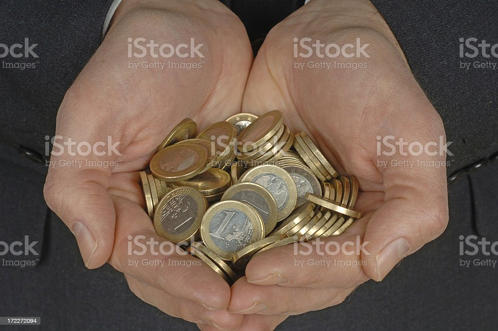 hard cash in a businessman´s hands stock photo