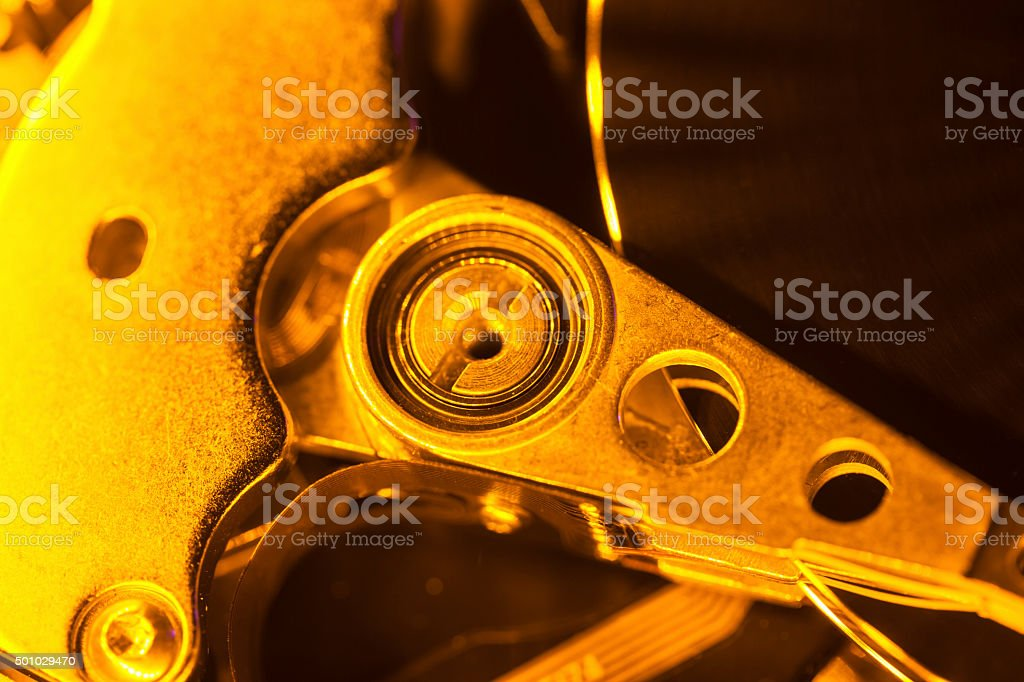 hard disc magnetic reading head handle under optic light stock photo