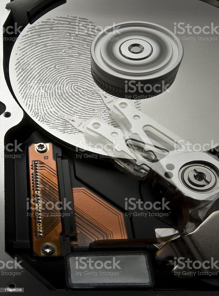 hard disk and fingerprint royalty-free stock photo