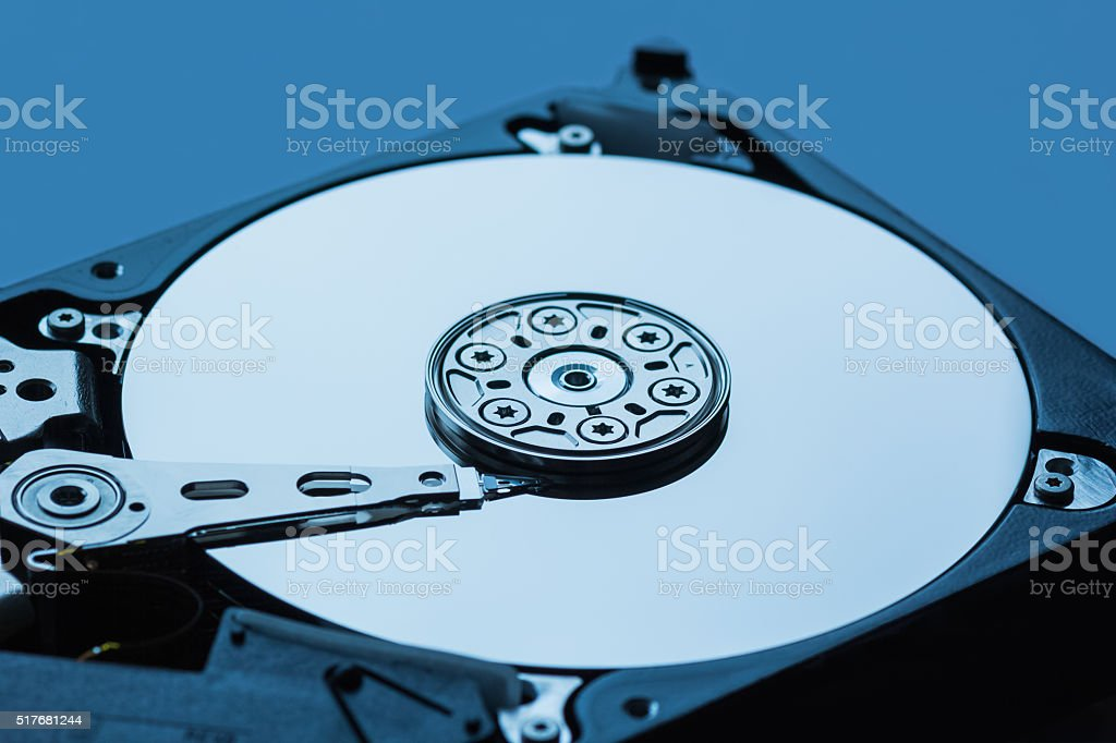 Hard disk drive open inside cylinder plates look head blue stock photo