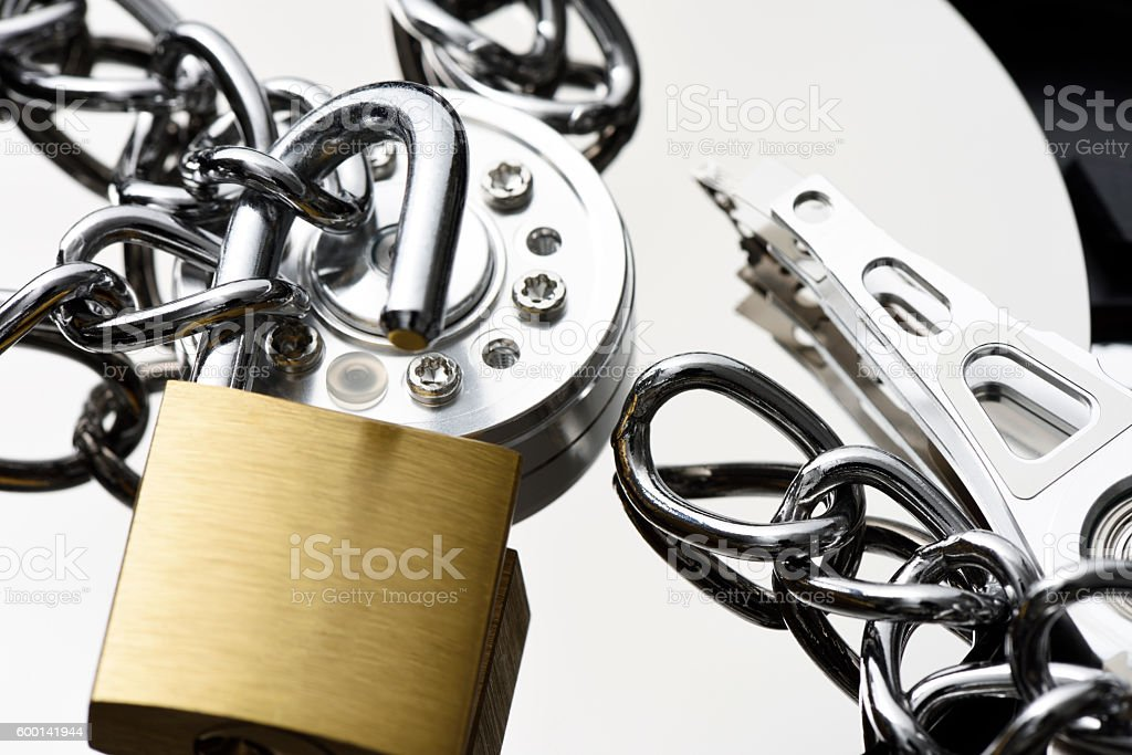 Hard disk drive with a unlocked padlock and chain stock photo