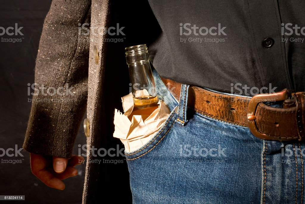 hard drinker with bottlt of alcohol stock photo