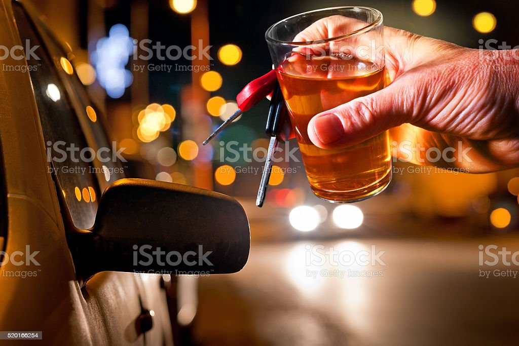 hard drinker with liqueur glass by night stock photo