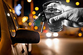 hard drinker with liqueur glass by night