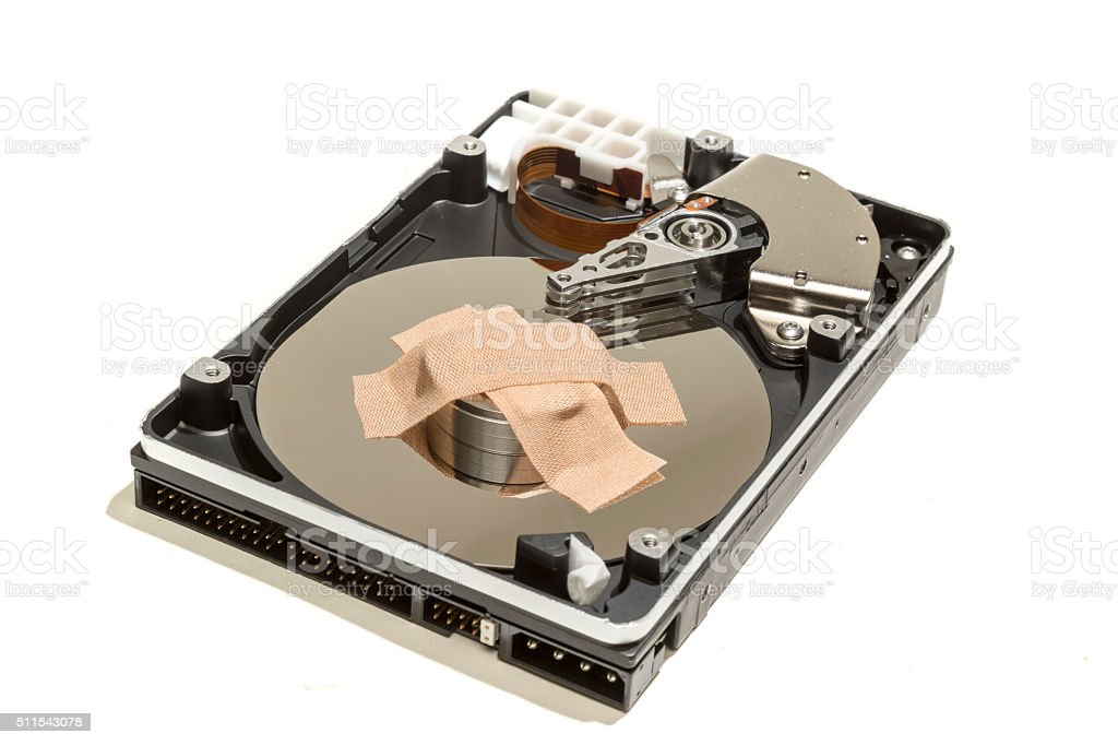 Hard Drive Being Healed with A Plaster stock photo