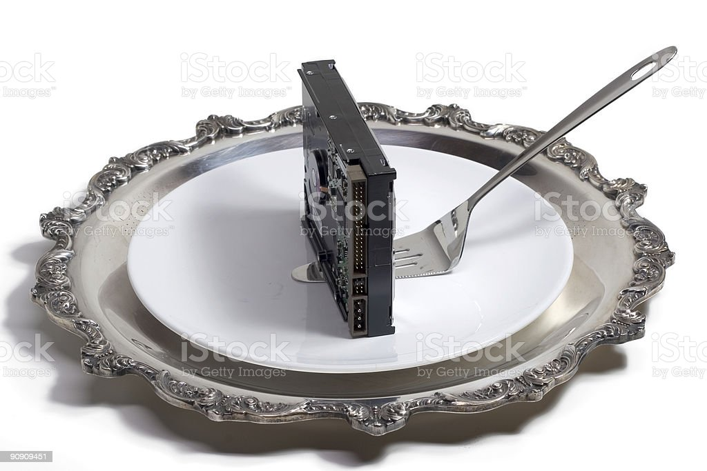 Hard drive served on a plate (isolated, clipping path) royalty-free stock photo