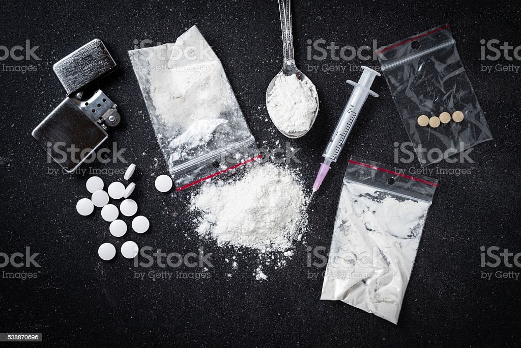 Hard drugs on dark table stock photo