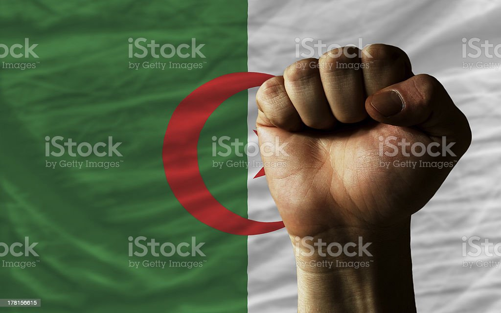 Hard fist in front of algeria flag symbolizing power royalty-free stock photo
