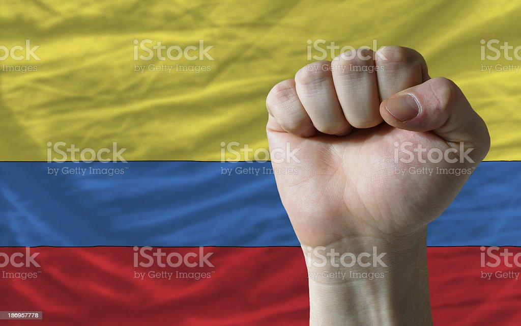 Hard fist in front of colombia flag symbolizing power royalty-free stock photo