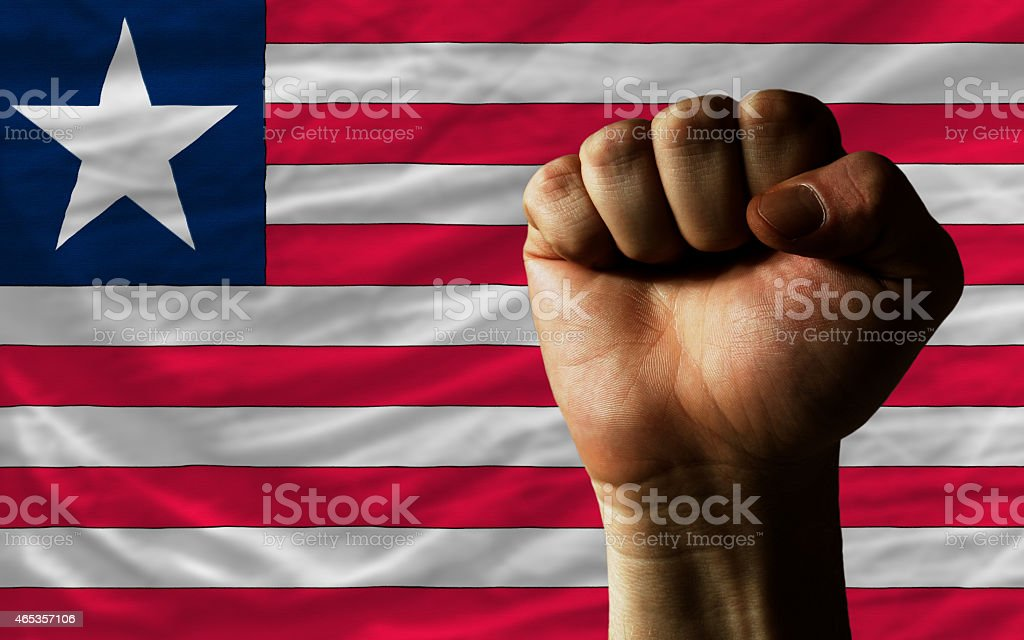 Hard fist in front of liberia flag stock photo