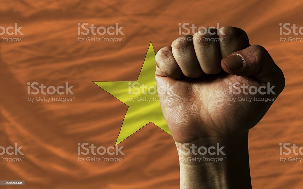 Hard fist in front of vietnam flag symbolizing power royalty-free stock photo