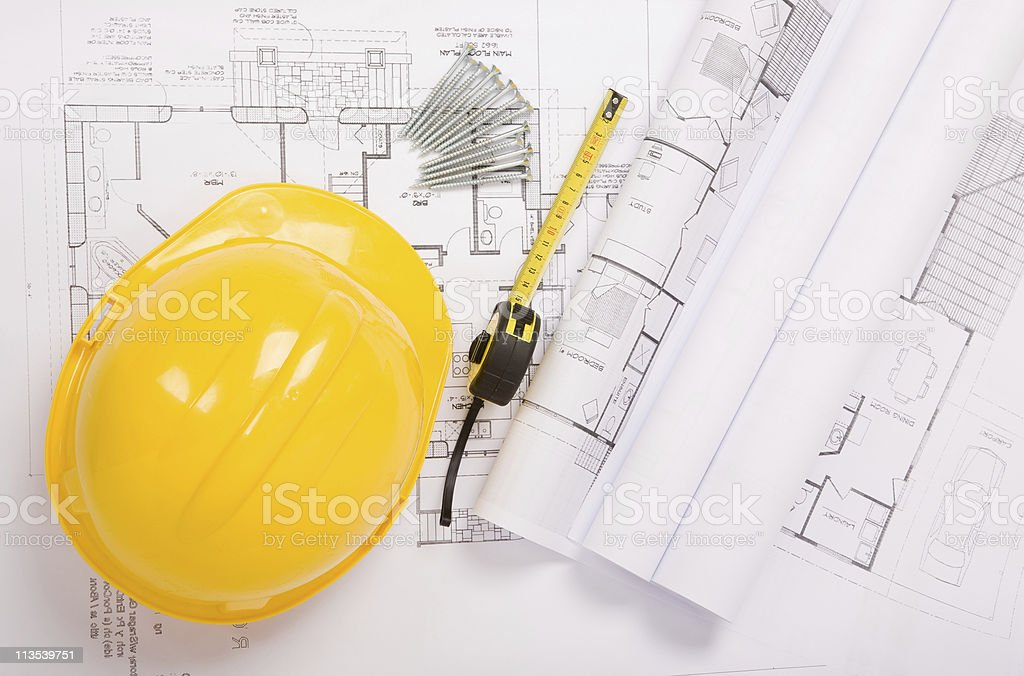 Hard hat and architectural plans royalty-free stock photo