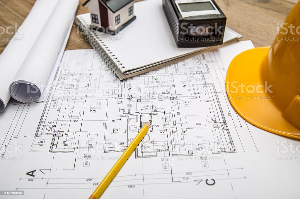 Hard hat and architectural plans stock photo