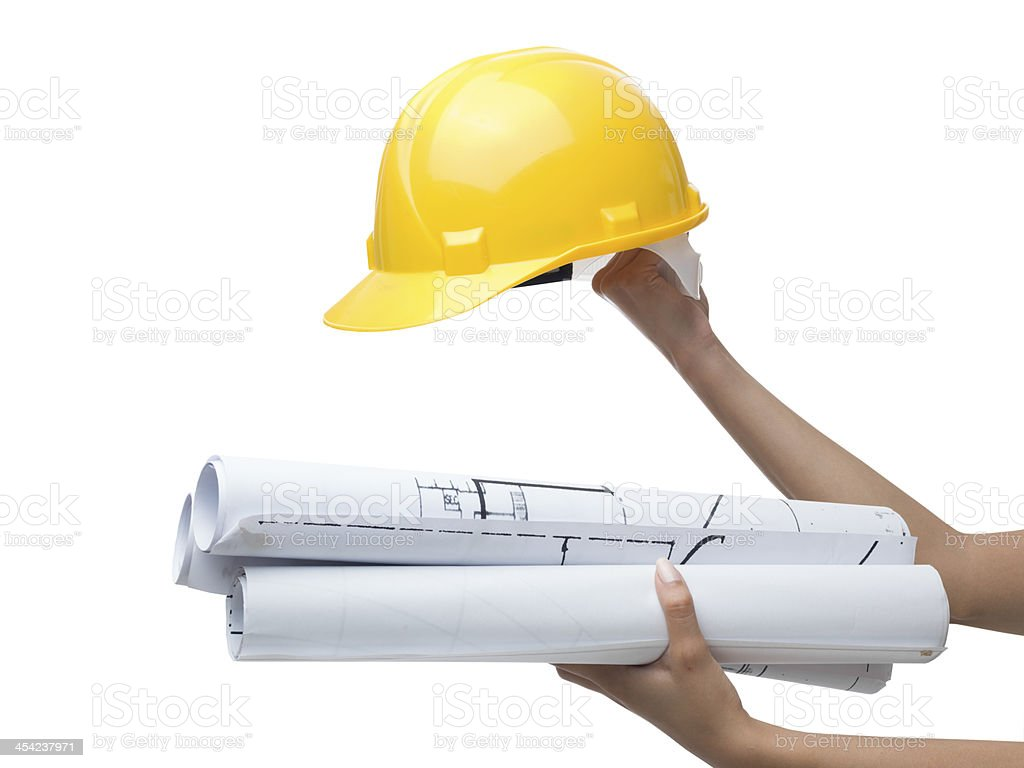 Hard hat and blue prints in human hands on white royalty-free stock photo