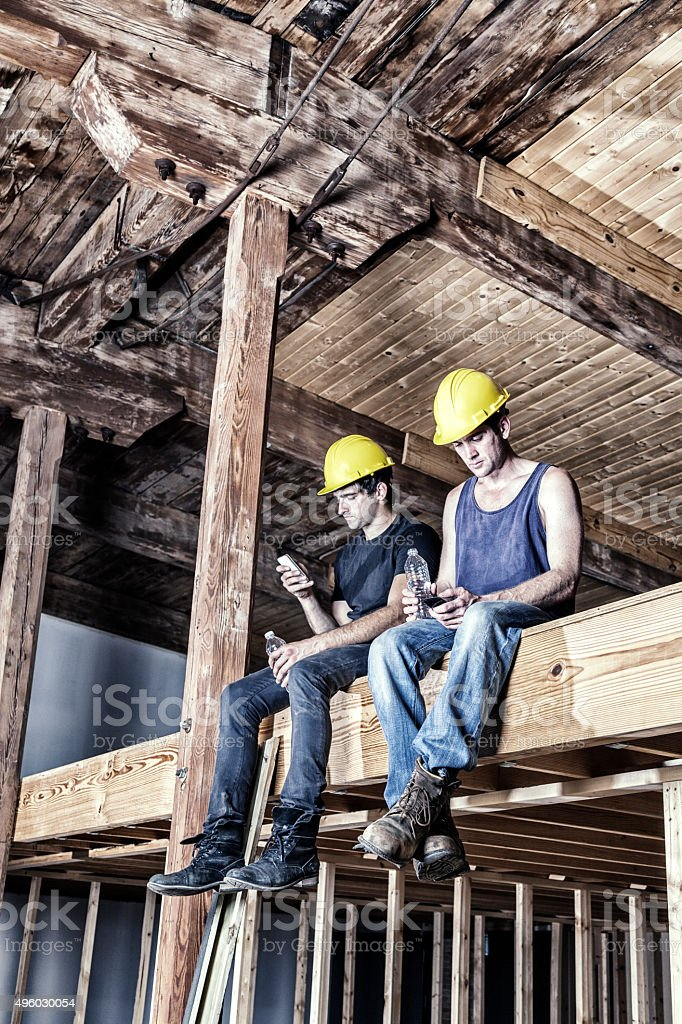 Hard Hat Building Construction Site Workers Resting On Work Break stock photo