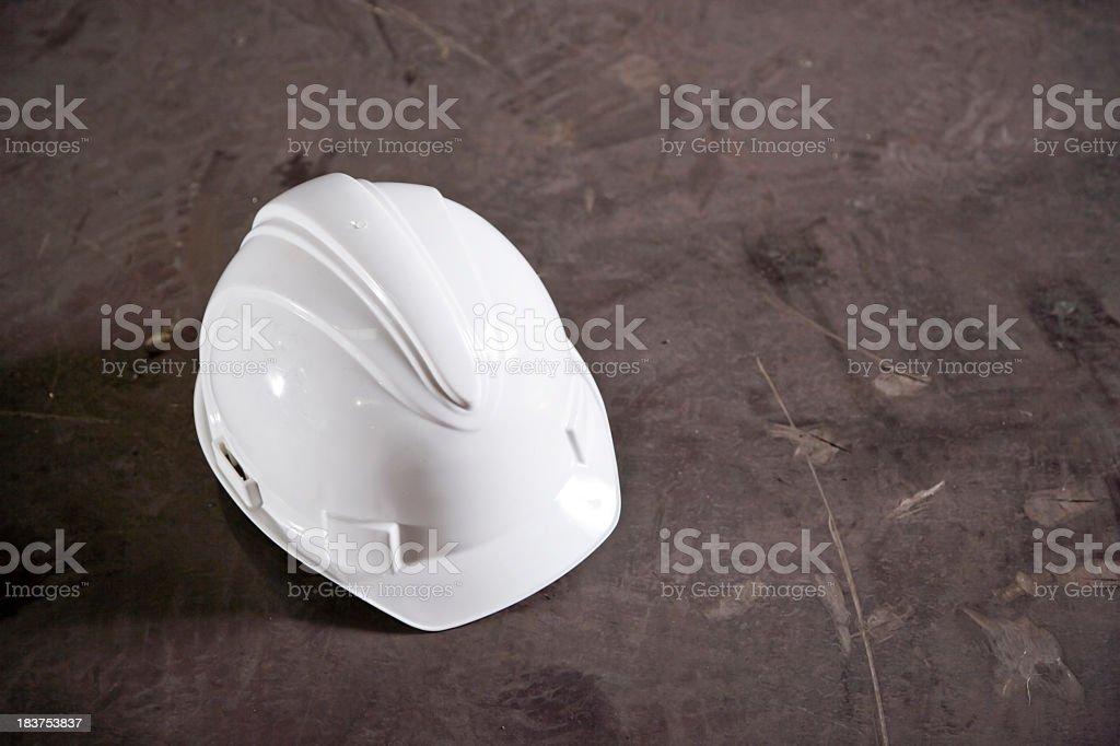 Hard hat on concrete floor stock photo