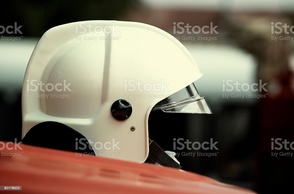 hard hat on the fire-engine stock photo
