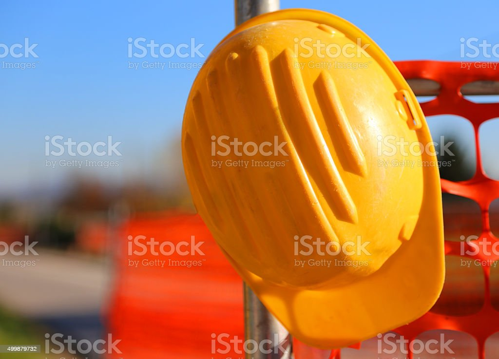 hard hat on the road construction site during road works stock photo