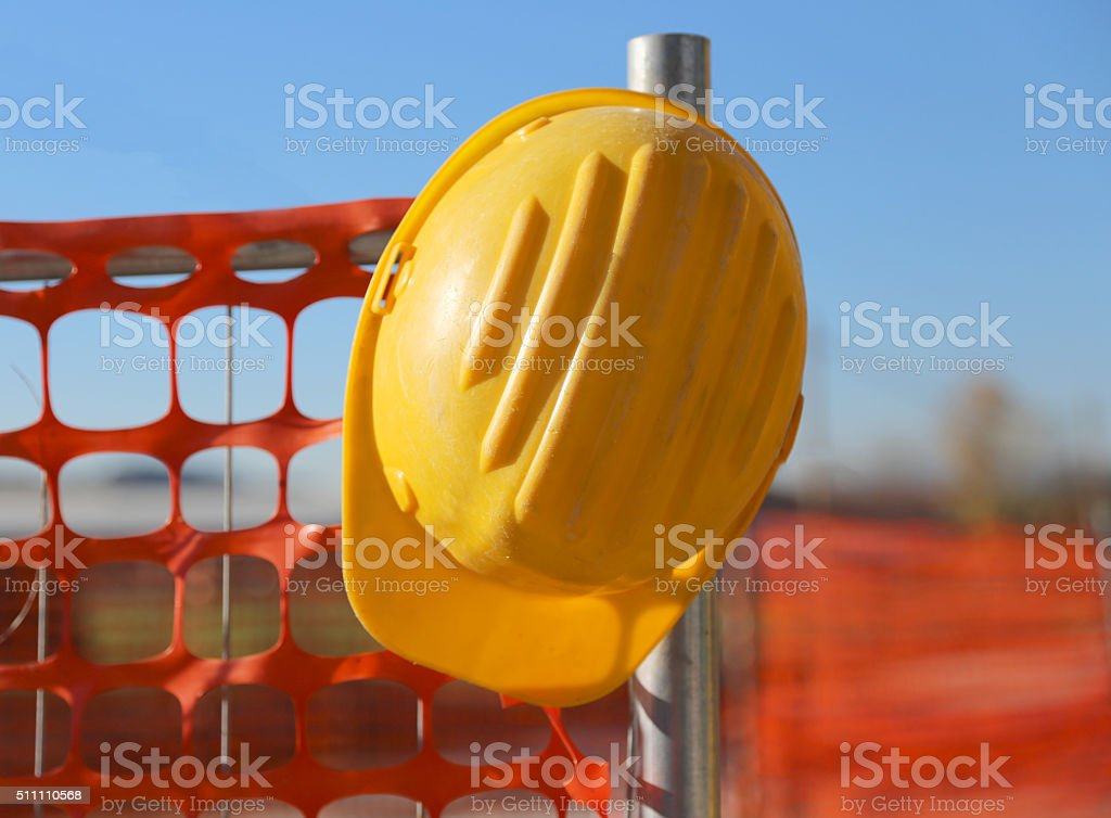 hard hat on the road construction site stock photo