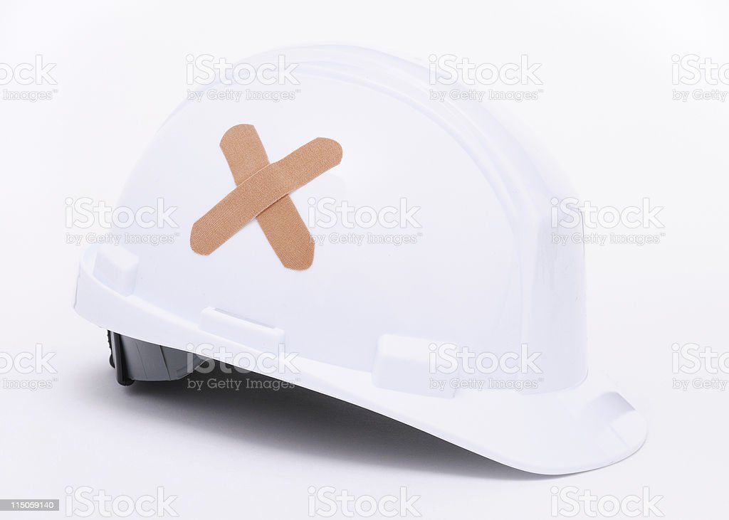 Hard Hat With Band Aids stock photo
