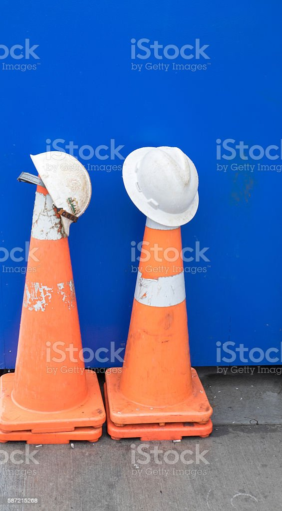 Hard hats and traffic cones stock photo