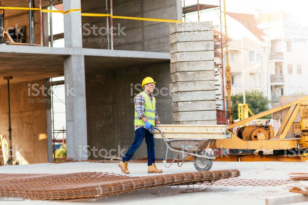 Hard labor on construction site stock photo