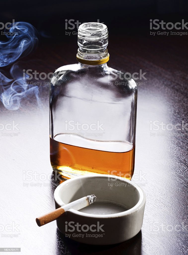 Hard Liquor and cigarette royalty-free stock photo