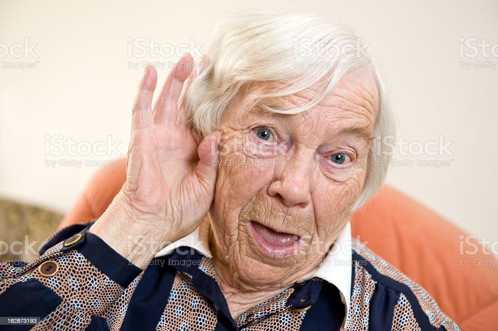 Hard of hearing female senior royalty-free stock photo