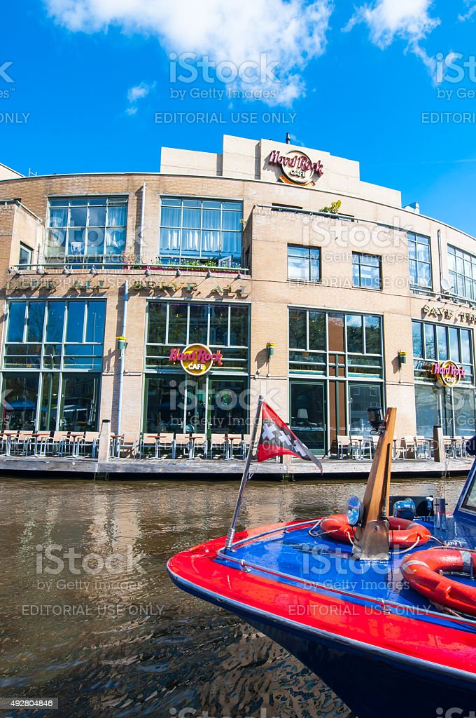 Hard Rock Cafe on the Singelgrachtkering Canal with boat. stock photo