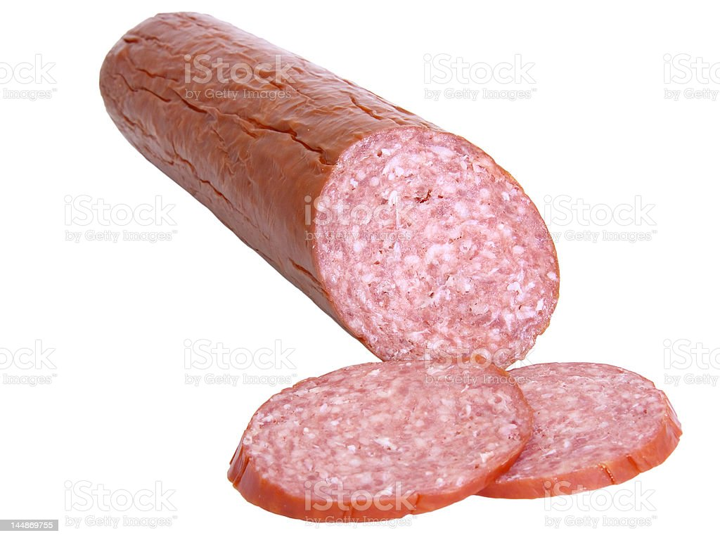 Hard salami and two slices isolated stock photo