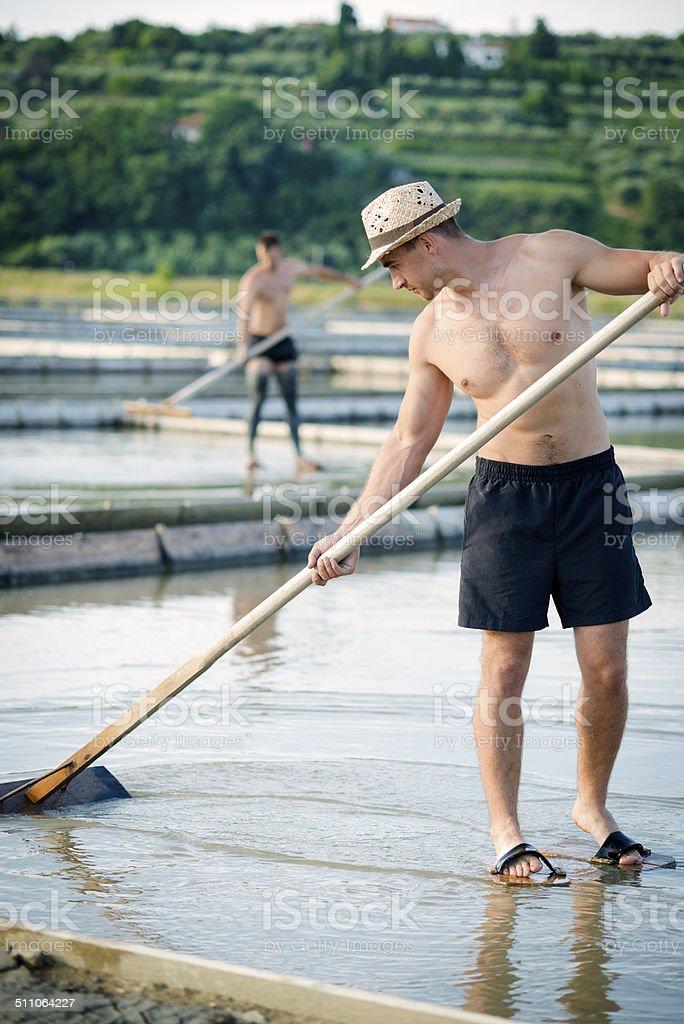 Hard Work at Salt Pans, Mediterranean, Europe stock photo