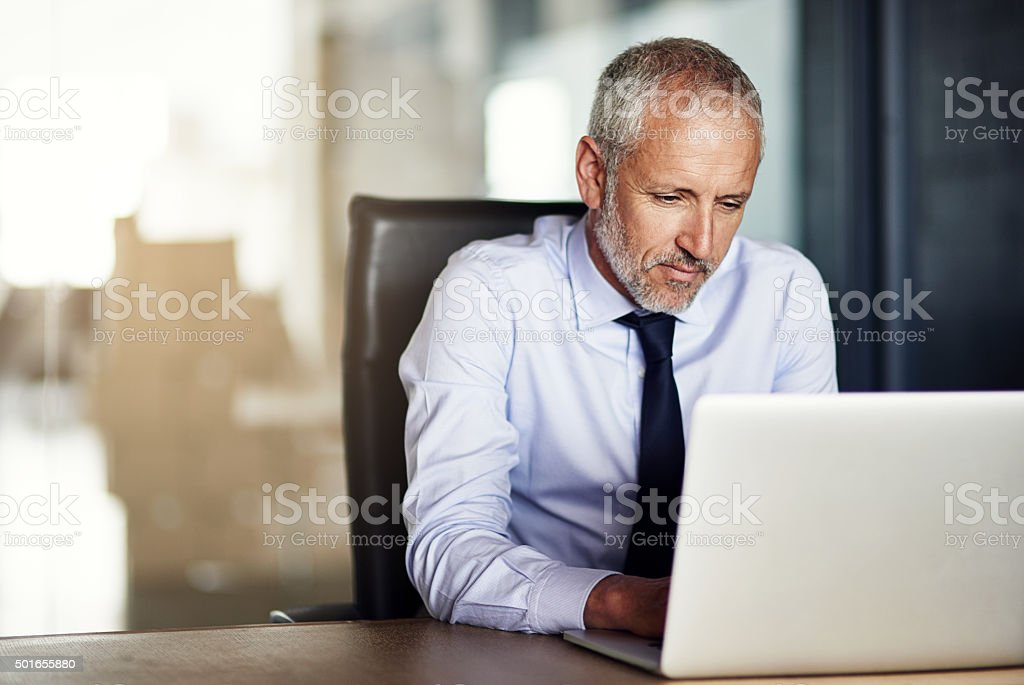 Cropped shot of a mature businessman working in his...