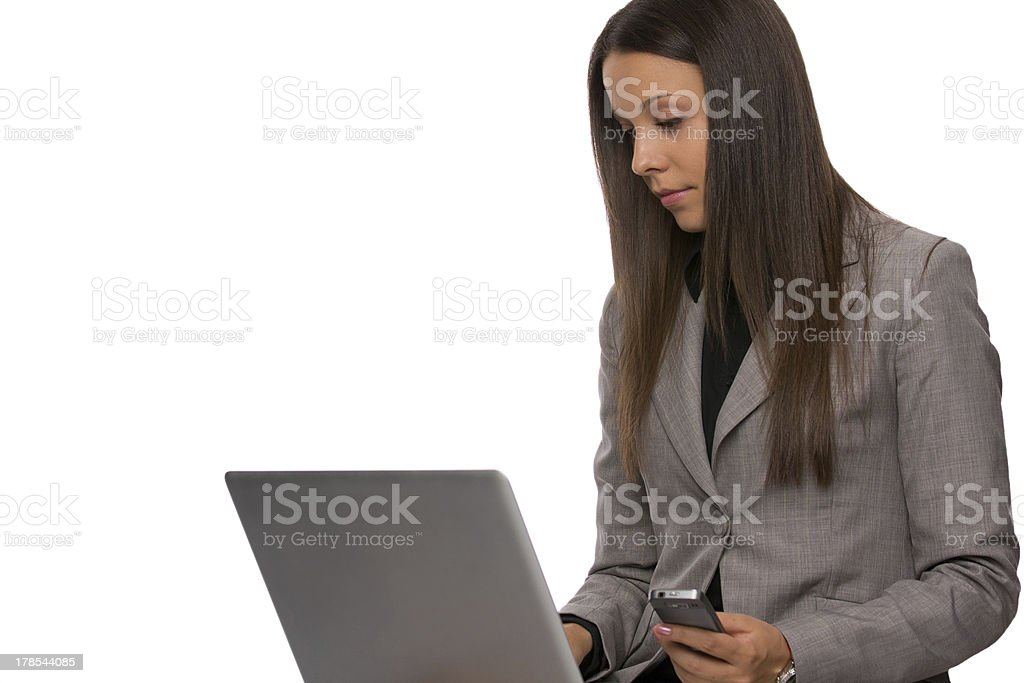 Hard working business woman with a laptop and phone royalty-free stock photo